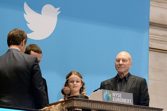 Vivienne Harr, accompanied by Sir Patrick Stewart, rings the bell for Twitter's IPO launch last November.