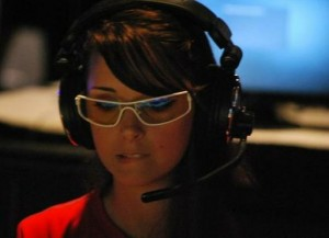 "Kelly ""MrsViolence"" Kelly is a professional competitive gamer from the USA.  She's been competing in tournaments since the age of 12 and has won over 15 tournaments, including Magic the Gathering and The Controller Battlefield 3 50k."