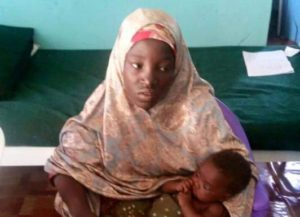 Undated picture released May 18, 2016 by Nigeria army of rescued Chibok schoolgirl and her baby in Maiduguri, Nigeria.  Nigeria Military/Handout via REUTERS TV