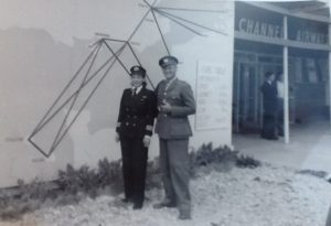 Jackie with husband Reg Moggridge outside Channel Airways building. Map on the wall shows the air routes flown by Channel Airways. Image courtesy of Candida Adkins.