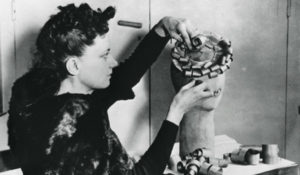 2. Woman making a hat from wood shavings