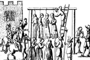 Suspected witches being hanged for the crime of witchcraft.