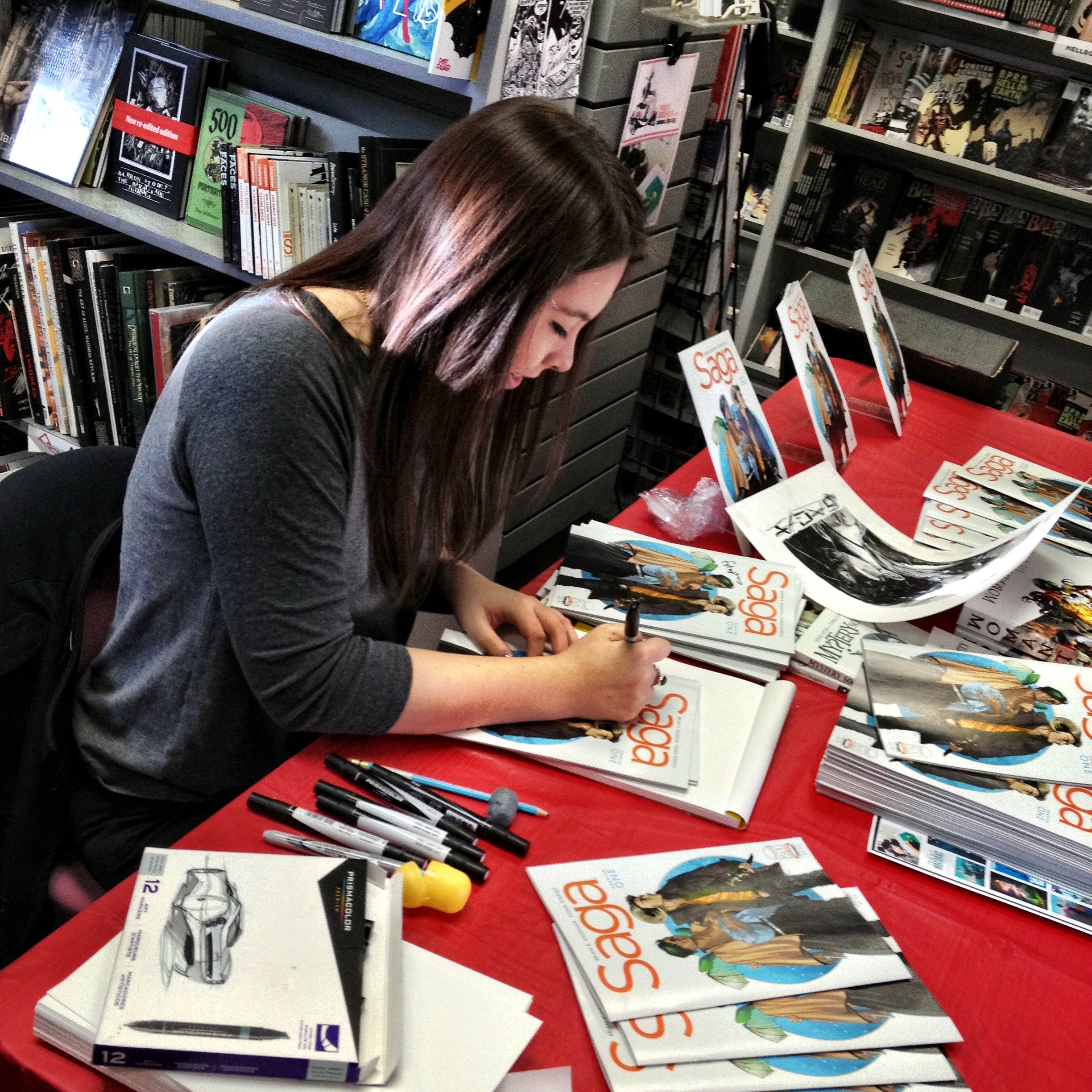Fiona Staples signing 'Another Dimension' comics. Image from Wikimedia Commons.