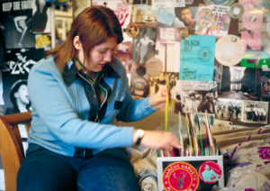 Girl sorting through music records