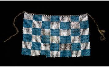 small beaded apron-like garment worn by a young girl