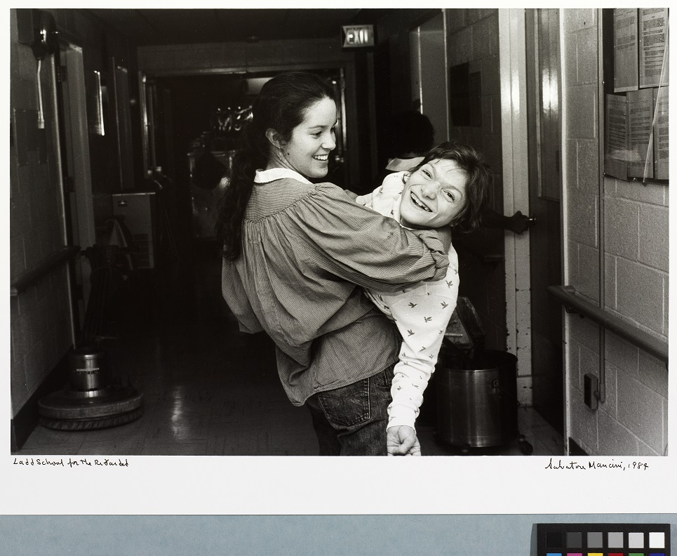Woman holding a young girl and smiling