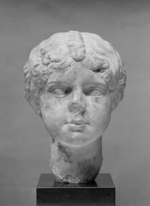 Bust of a young girl with curly hair