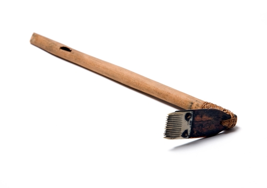 Wooden handle with brush on end for tattooing