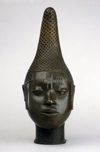 Cast bronze head of a young woman, probably representing Queen Idia. The eyes are inlaid with iron.