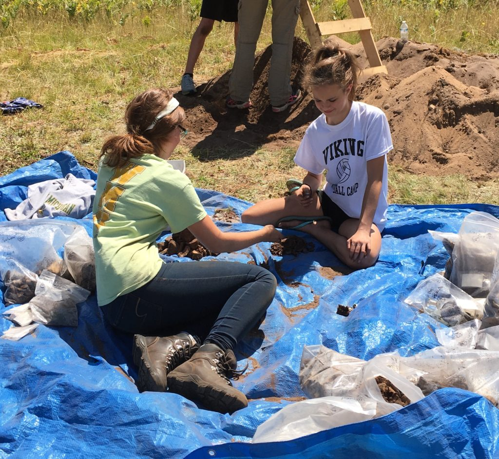 Junior Girl Maria Smith writes about her experiences on an archaelogical dig in 2014, and the children's items, toys, and dolls that were found.