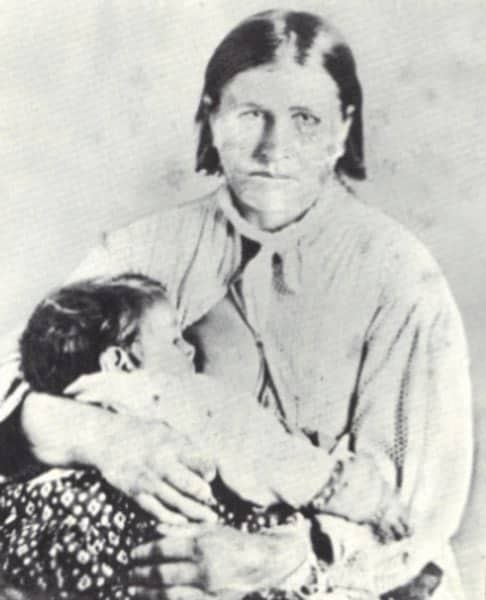 Woman holds a small boy