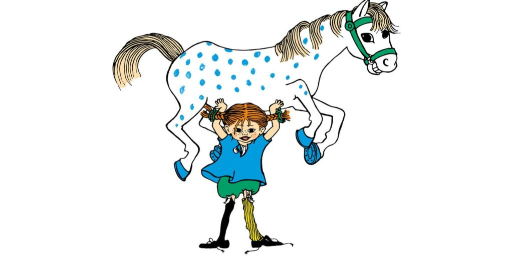 Little girl in blue shirt, green shorts, with red pigtails holding up a blue spotted horse