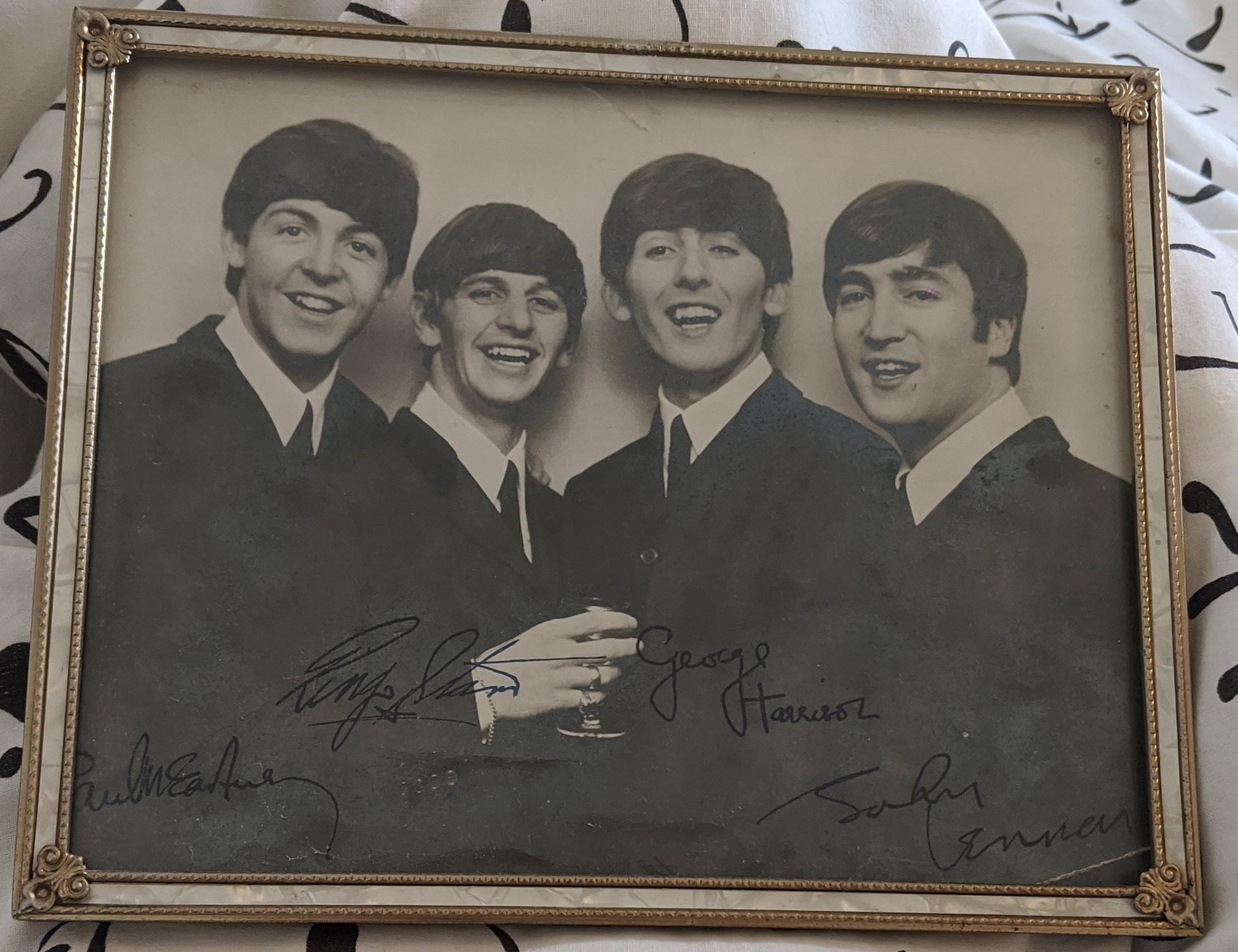 Framed photograph of the Beatles during their younger days.