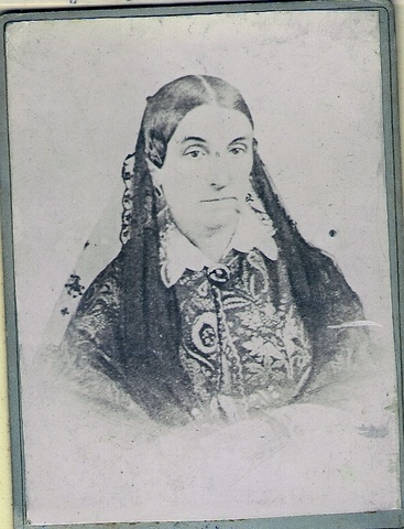 Photograph of a middle-aged woman in a veil