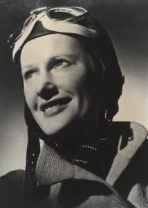 Portrait of Nancy in aviator outfit