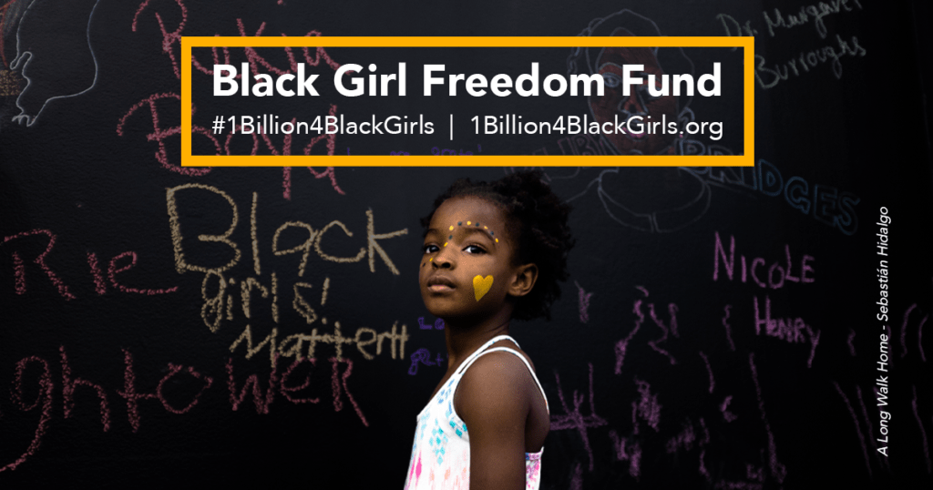 Black Girl Freedom Fund text below which stands a black girl looking off into the distance in front of a chalkboard with Black women's names
