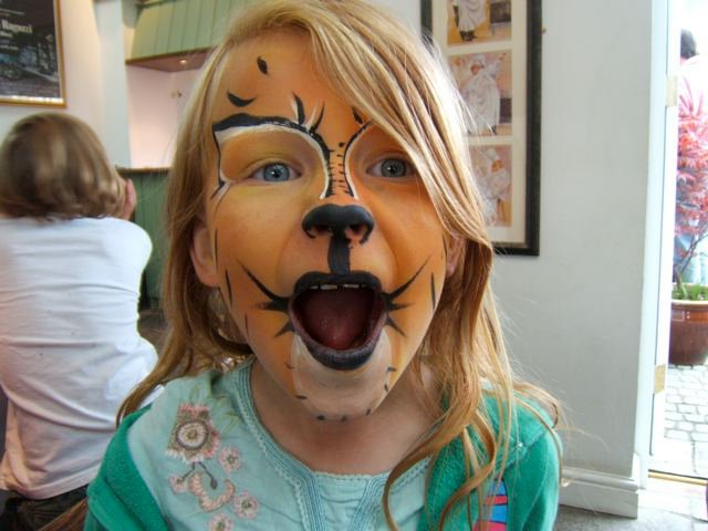 Topaz as a girl with tiger face paint