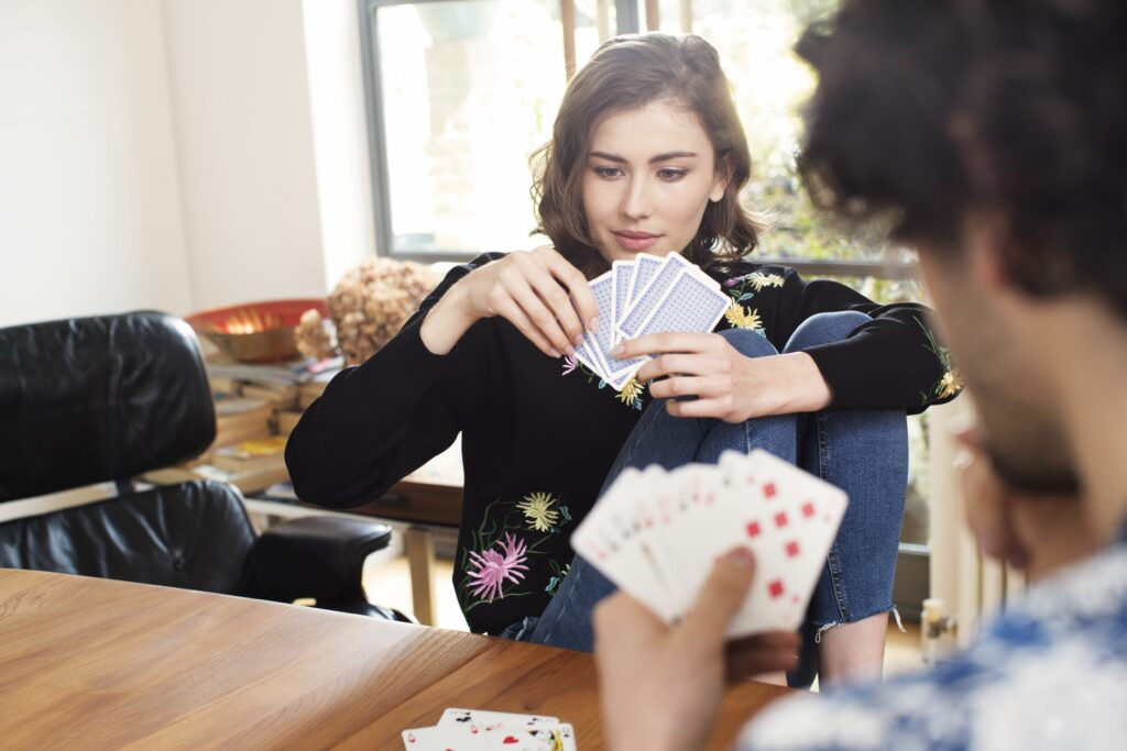 Young women playing cards