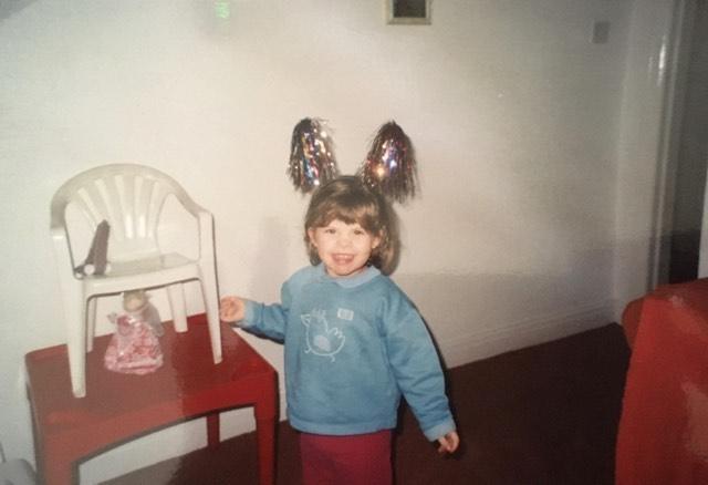 Izzie Heis as a toddler