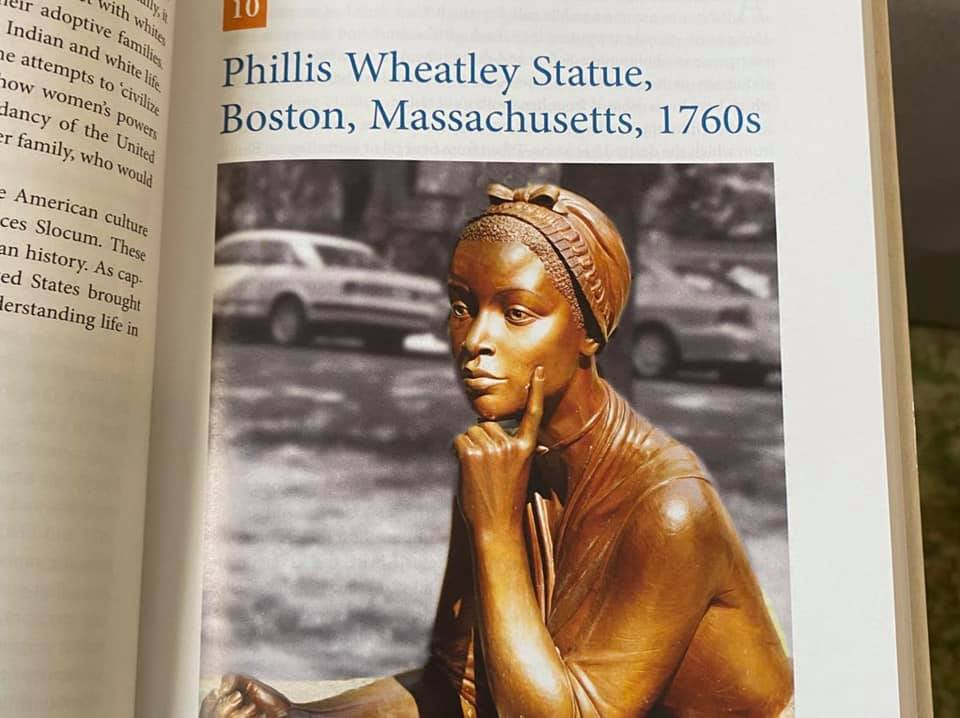 Photograph of page of a book showing statue of Phyllis Wheatley